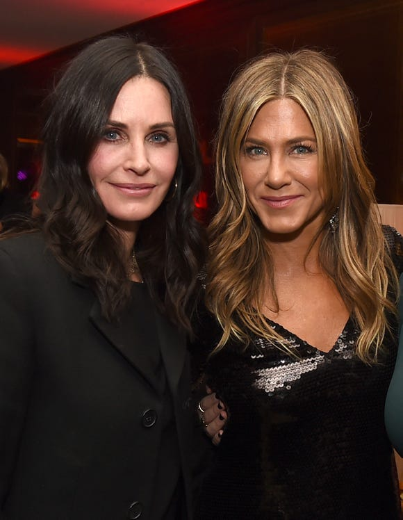 "Courteney Cox (L) and Jennifer Aniston pose at the after party for the premiere of Netflix's ""Dumplin'"" in December."