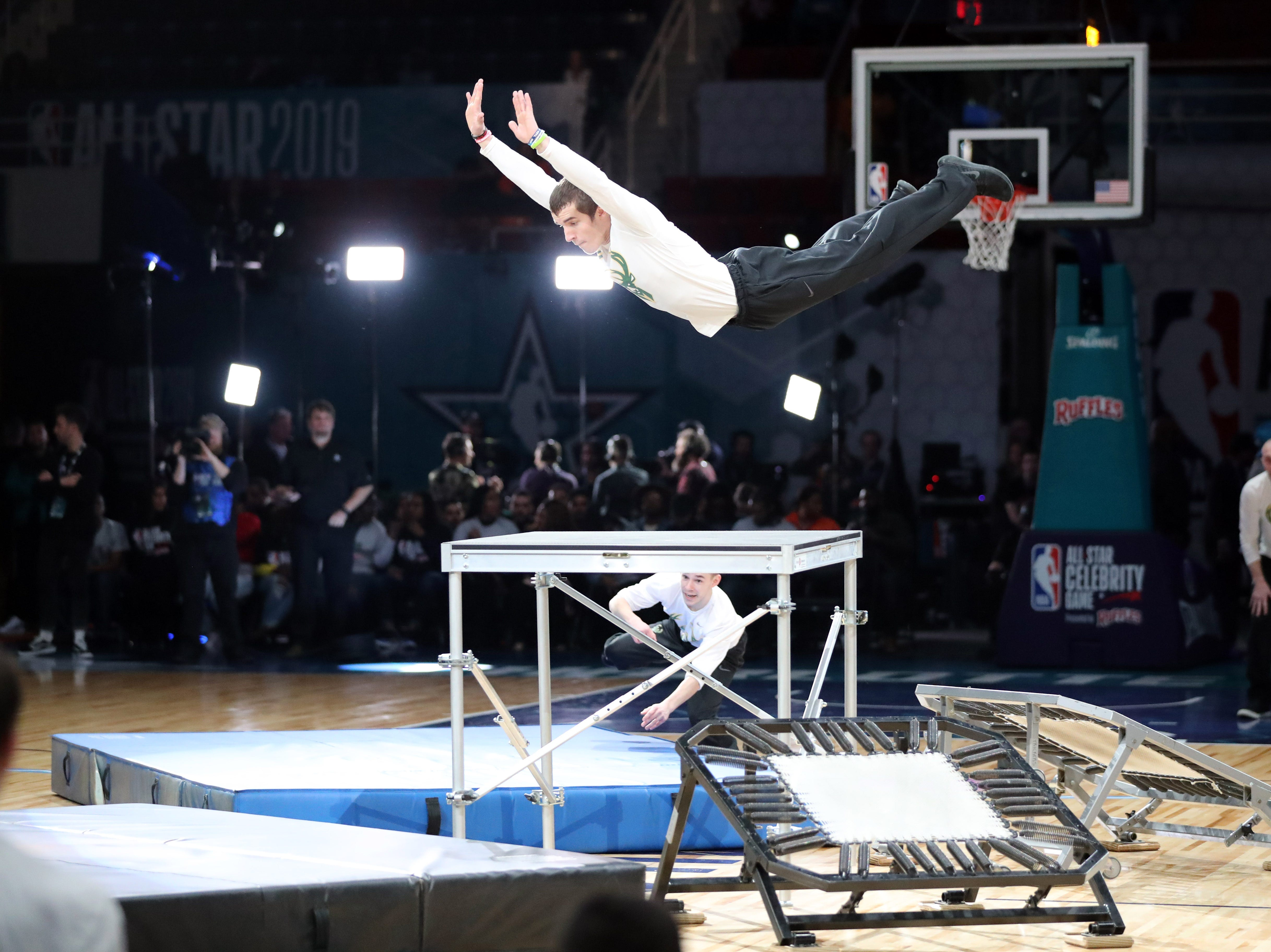 A Milwaukee Bucks stunt man performs before the Celebrity Game.