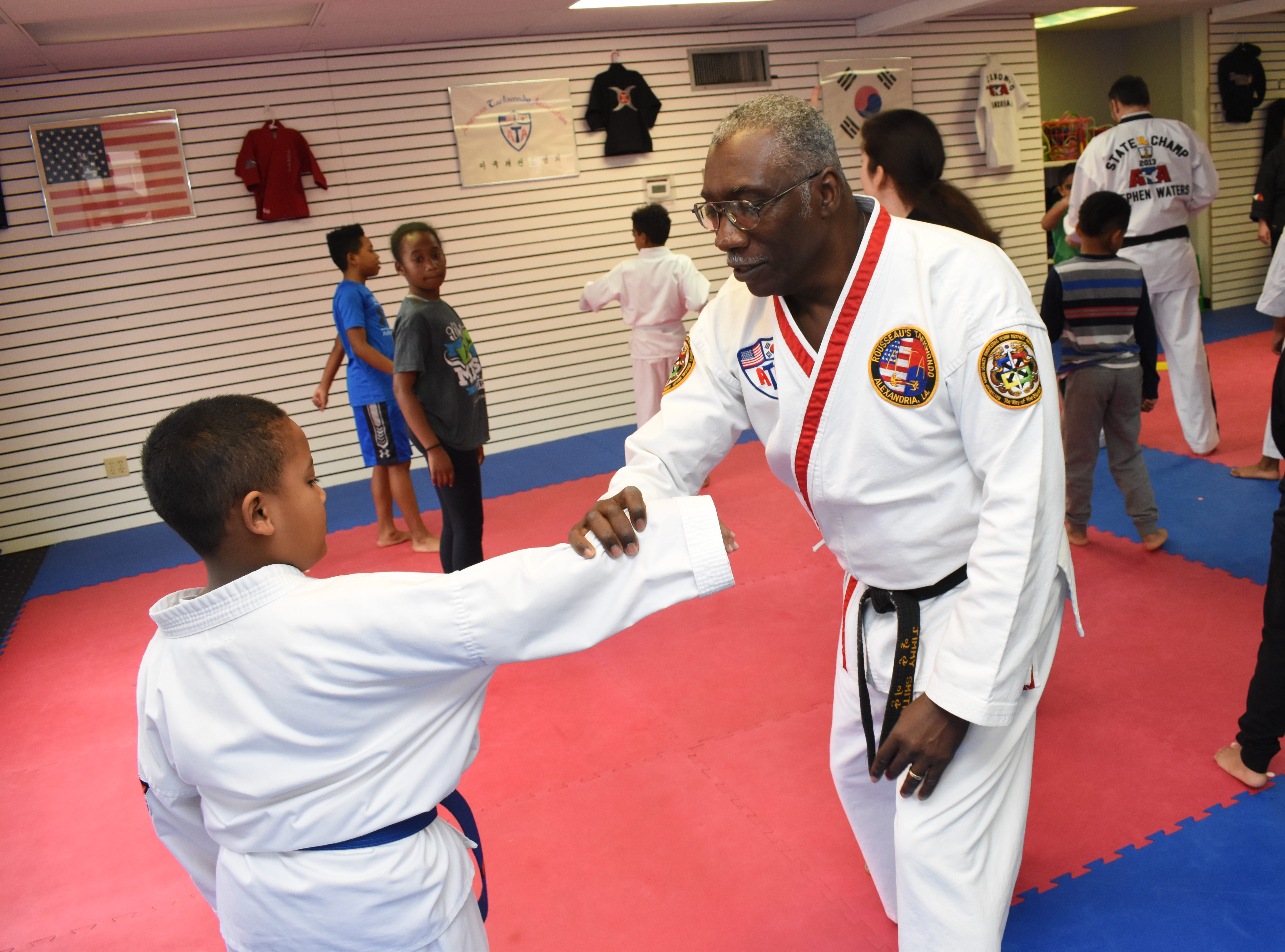 """A free """"Stranger Danger"""" defense class for children ages 7-12 was held Saturday, Feb. 16, 2019 at Master Rousseau's Taekwondo located on Jackson Street. Children were taught self-defense techniques to use if they to be grabbed by someone they did not know. They were advised to fight back and yell loudly. Also on hand to talk to the children were Rapides DARE officers Derek Parker with the Pineville Police Department and Vern Rennier with the Alexandria Police Department."""