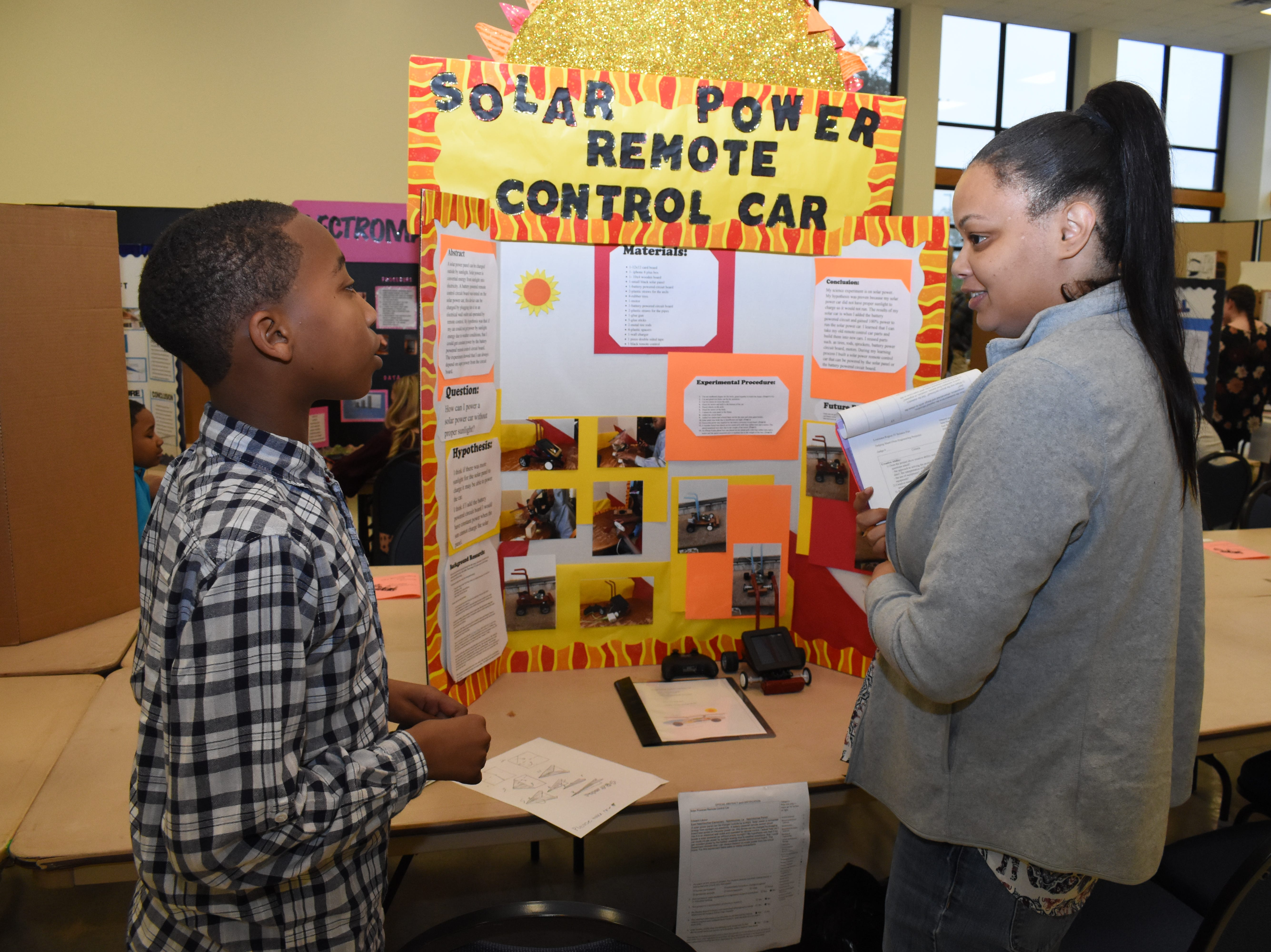 Edward LaCour (left), a fifth-grader from East Natchitoches Elementary and Middle School, presents his science project on a solar powered remote control car to Davida Crossley who was one of the judges for the Louisiana Region IV Science and Engineering Fair held Saturday, Feb. 16, 2019 at Louisiana State University of Alexandria. Students from Grant, Avoyelles, and Rapides parishes competed in numerous categories. Students displayed project boards and presented experiments to the judges.