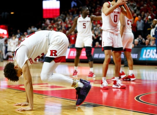 Rutgers Scarlet Knights guard Caleb McConnell (22) and guard Geo Baker (0) react after losing to the Iowa Hawkeyes