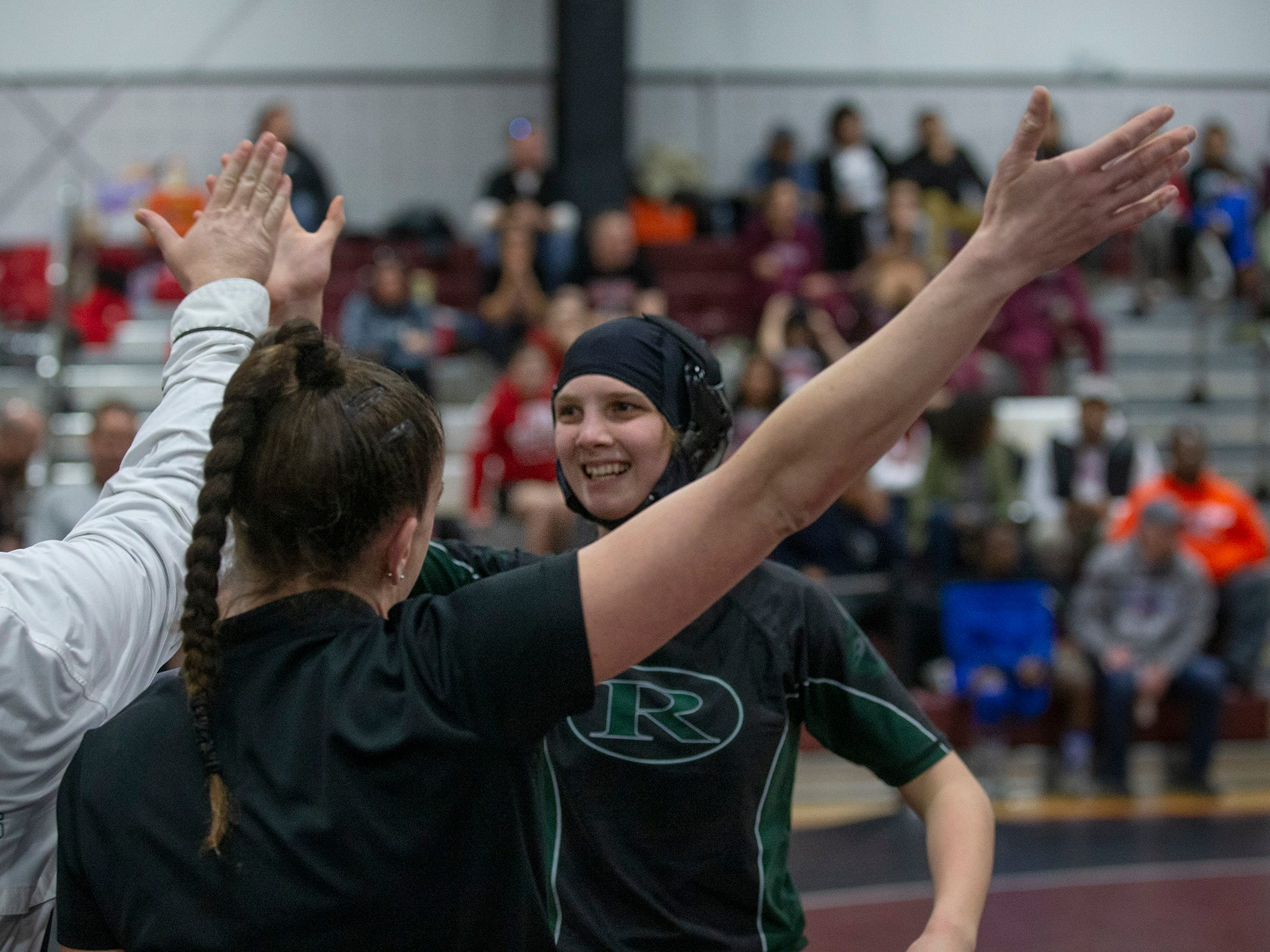 Raritan's Karena Wong  celebrates with coaches after defeaing Warren Hills Katrina Kling in the semifinals NJSIAA Girls Region Wrestling at Red Bank Regional High School in Red Bank NJ on February 17, 2019.