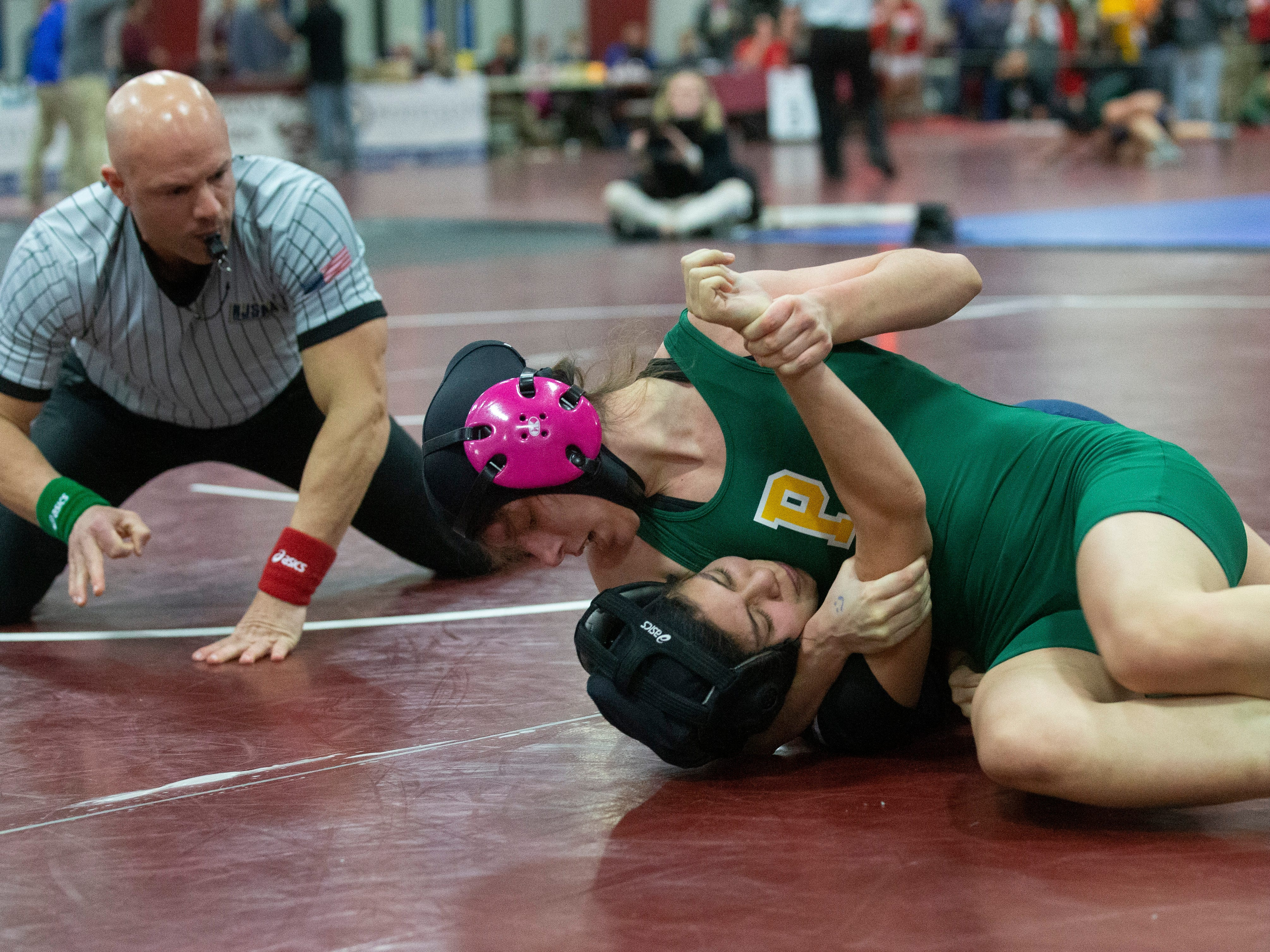 Pinelands Regional's Olivia Mena goes for pin of Notre Dame's Angelina Hernandez in their 118 lbs. bout. NJSIAA Girls Region Wrestling at Red Bank Regional High School in Red Bank NJ on February 17, 2019.