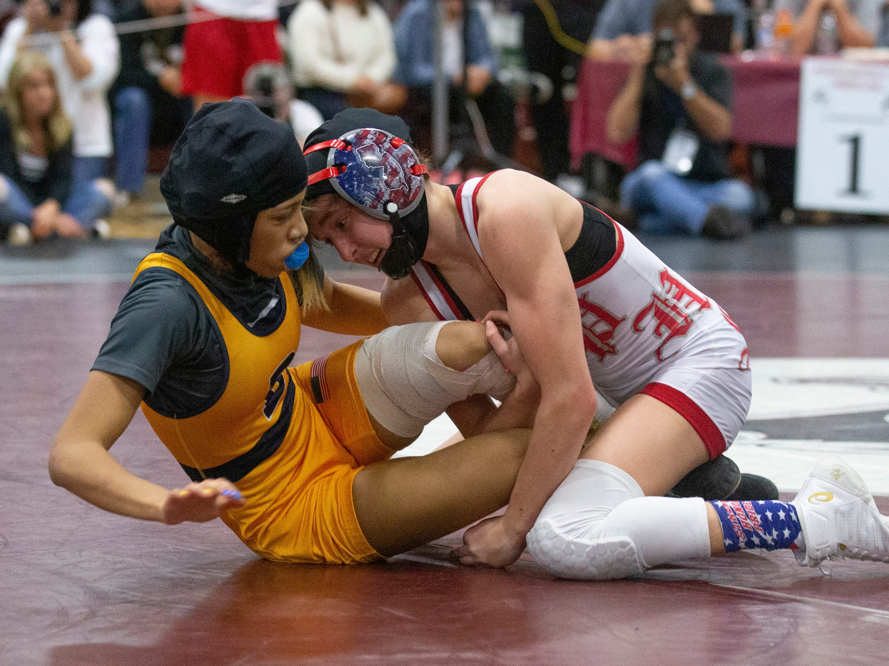 Parsippany's Sydney Petzinger works to control Belleville's Alisa Saffold in their 100 lbs North Region bout. NJSIAA Girls Region Wrestling at Red Bank Regional High School in Red Bank NJ on February 17, 2019.