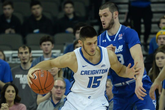 Creighton Bluejays forward Martin Krampelj (15) drives against Seton Hall Pirates forward Sandro Mamukelashvili (23) in the first half