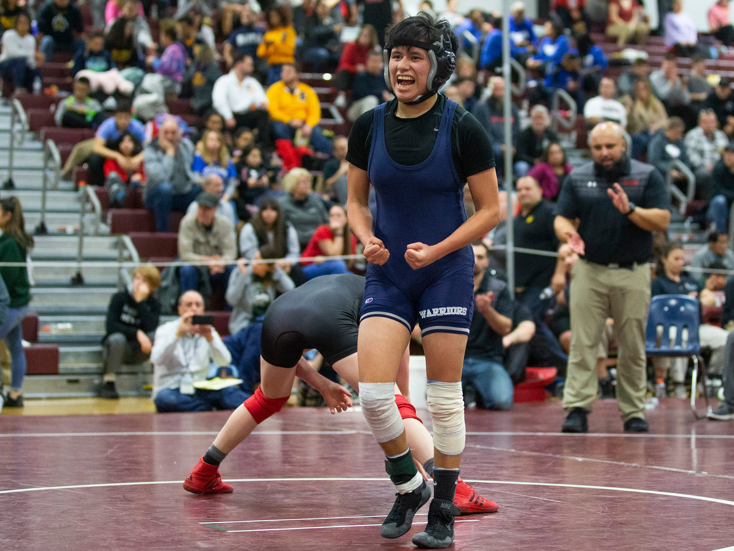 Manasquan's Bella Serrano celebrates after win over  Kingsway's Mia Bruno in their 111 lbs. bout. NJSIAA Girls Region Wrestling at Red Bank Regional High School in Red Bank NJ on February 17, 2019. NJSIAA Girls Region Wrestling at Red Bank Regional High School in Red Bank NJ on February 17, 2019.