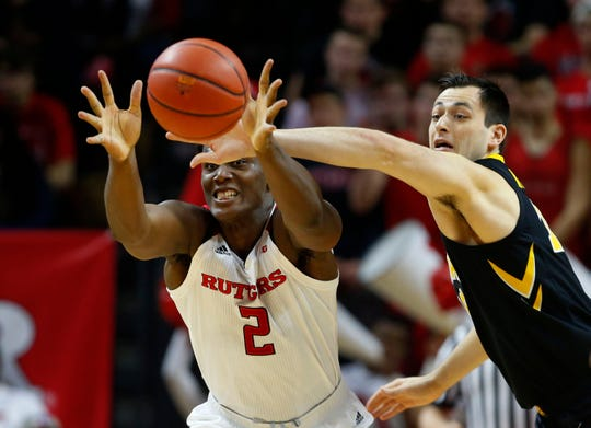 Iowa Hawkeyes forward Ryan Kriener (15) defends against Rutgers Scarlet Knights center Shaquille Doorson (2)