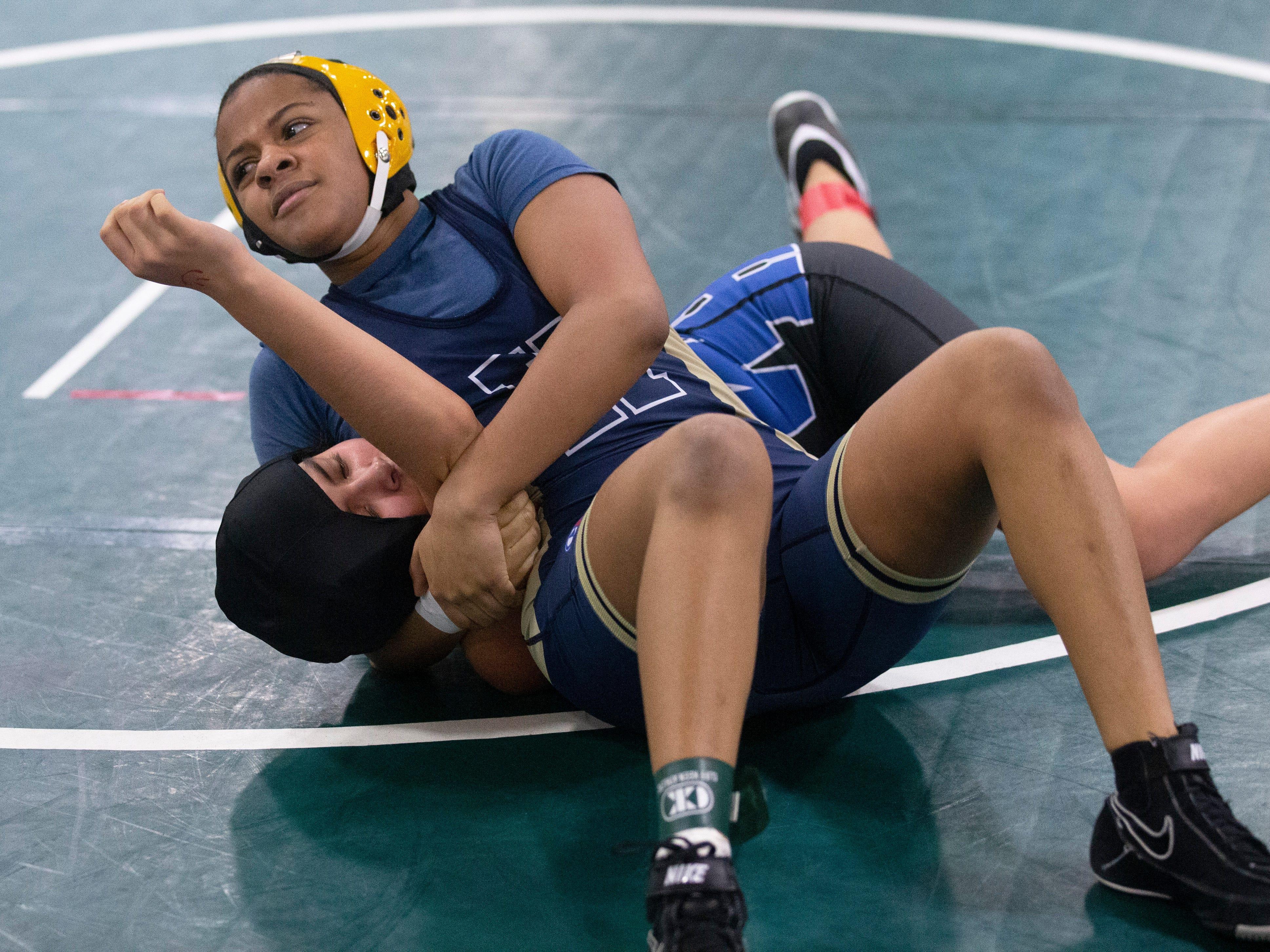 Hackensack's Nicole Montero pins Warren Hill's Reina Castro-Gomez in their 118 lbs. bout. NJSIAA Girls Region Wrestling at Red Bank Regional High School in Red Bank NJ on February 17, 2019.