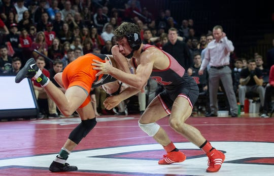 Rutgers' Nick Suriano (right) is shown wrestling Princeton's Jonathan Gomez on Feb. 3, was defeated by Michigan's top-ranked 133-pounder Stevan Micic 3-2 on Sunday afternoon.