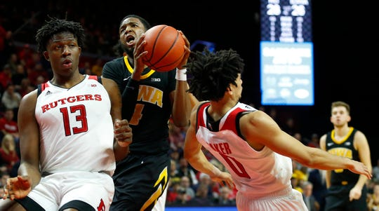 Rutgers Scarlet Knights forward Shaq Carter (13) defends with guard Geo Baker (0) who is called for a foul against Iowa Hawkeyes guard Isaiah Moss (4)