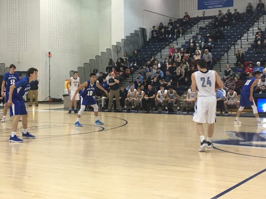Freehold Township's Cristian Corcione (24) sets up a play against Holmdel as the Hornets' Derek Chan (10) and Eric Hinds (far left) and Alex Baker (12) watch the play during the SCT quarterfinal game on Feb. 17, 2019 at the RWJ Barnabas Health Arena.