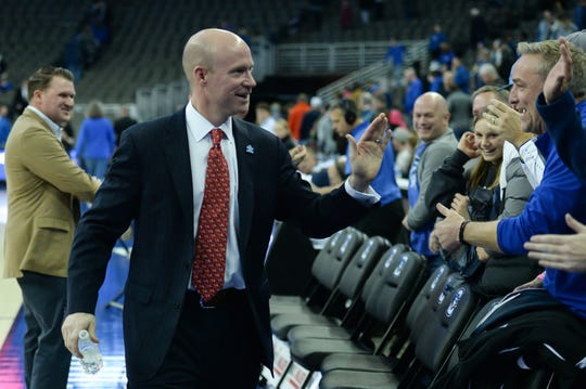 Seton Hall Pirates head coach Kevin Willard greets fans after the win against the Creighton Bluejays