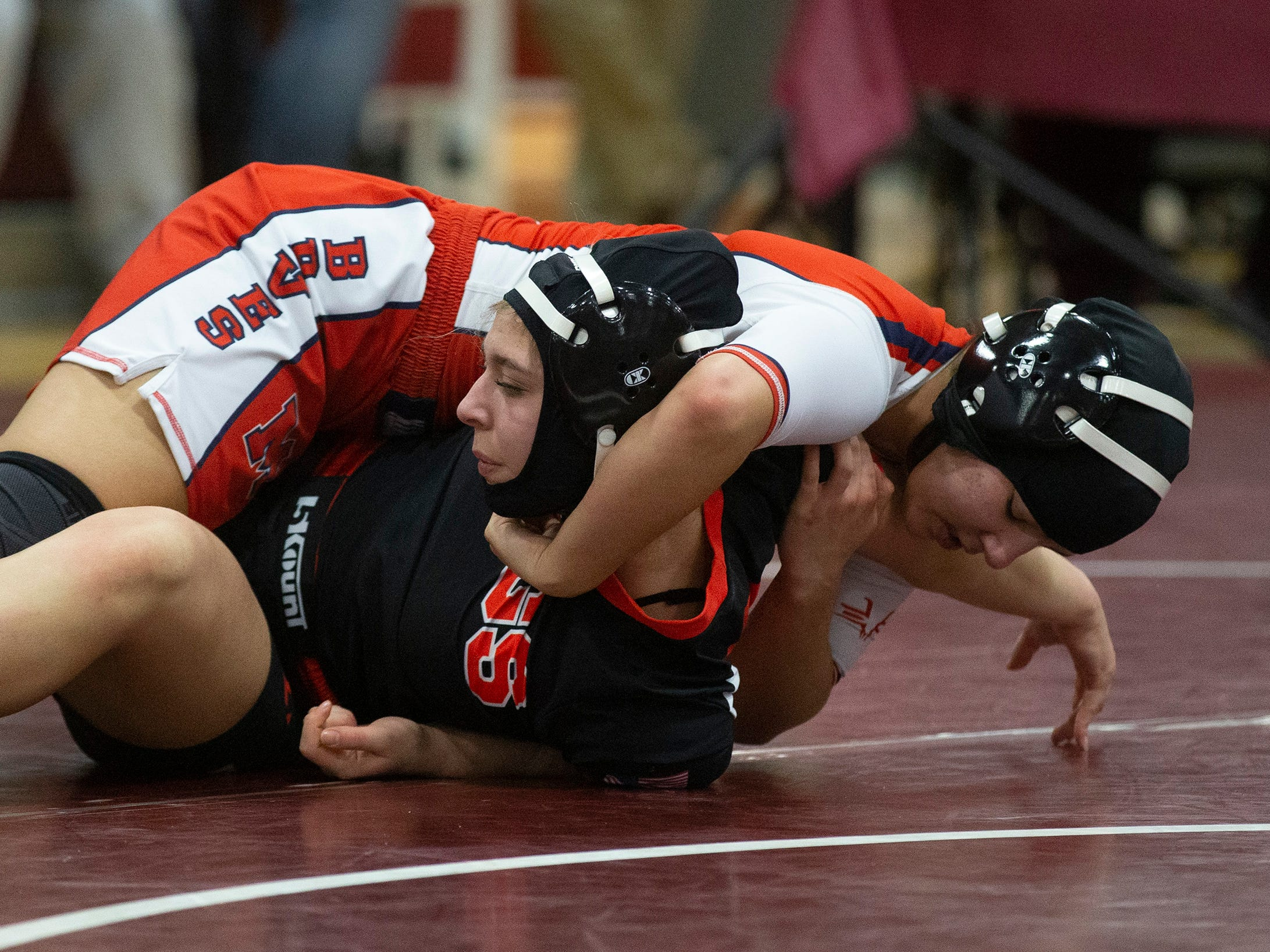 Manalapan's Angelina Vitola works for back points against Jackson Memorial's Kayla Gregory in their 127 lbs. bout. NJSIAA Girls Region Wrestling at Red Bank Regional High School in Red Bank NJ on February 17, 2019.