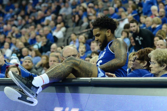 Seton Hall Pirates guard Myles Powell (13) climbs out of the court side seats after reaching for a loose ball against the Creighton Bluejays