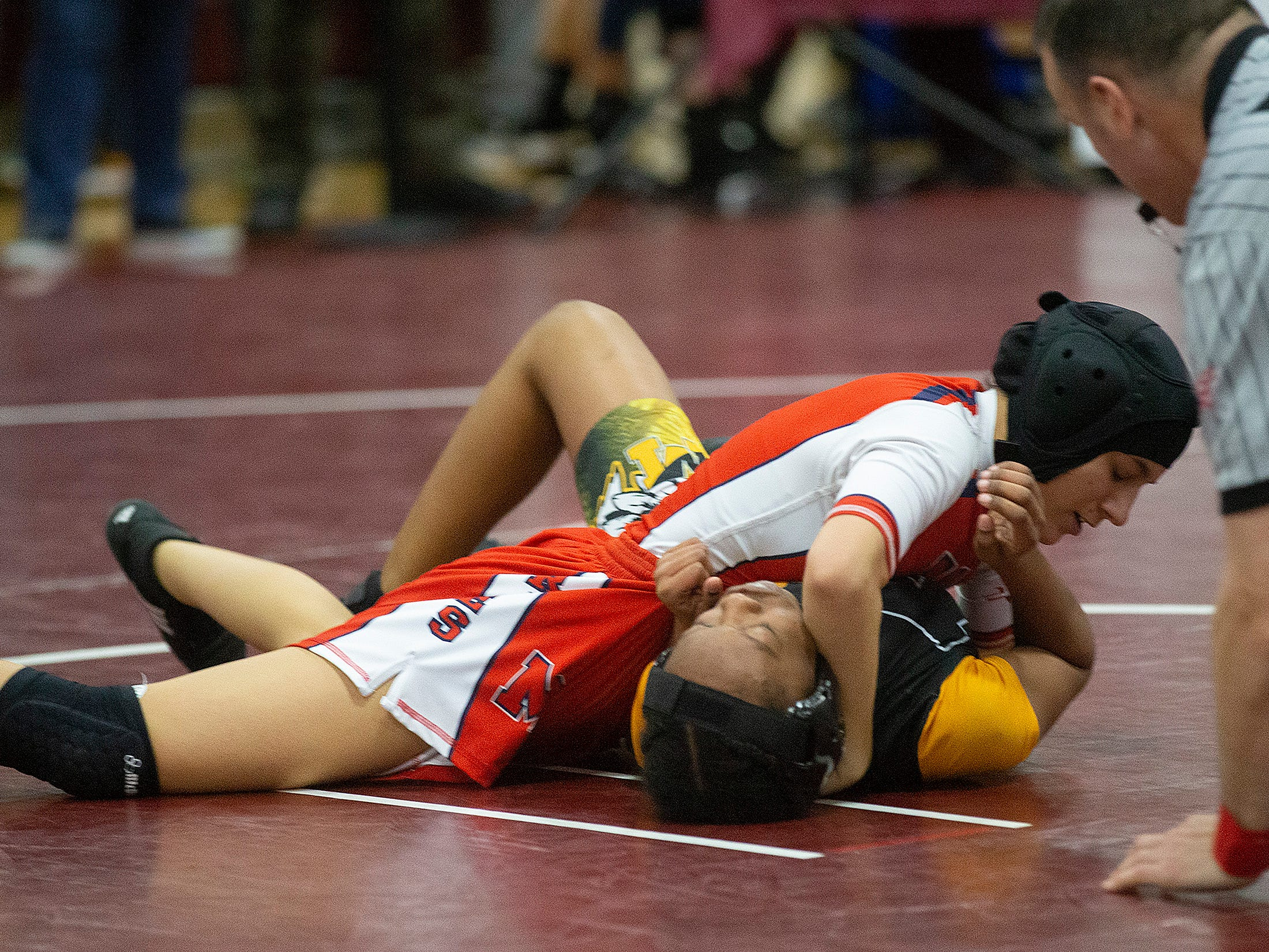 Manalapan's Julia Manolas looks for back points in 105 lbs. match against Monmouth Regional's Mya House. NJSIAA Girls Region Wrestling at Red Bank Regional High School in Red Bank NJ on February 17, 2019.