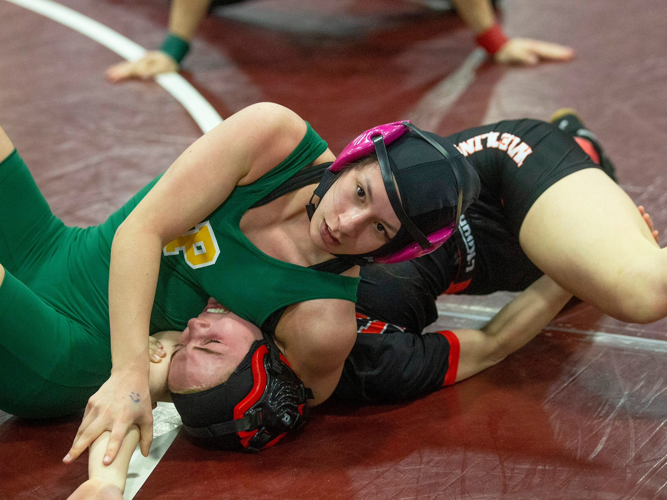 Pinelands Regional's Olivia Mena gets a pin against Jackson Memorial's Avery Meyers in their 118 lbs. bout. NJSIAA Girls Region Wrestling at Red Bank Regional High School in Red Bank NJ on February 17, 2019.