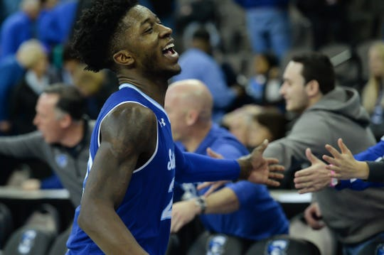 Seton Hall Pirates guard Myles Cale (22) celebrates with fans after the win against the Creighton Bluejays
