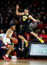 Iowa Hawkeyes guard Joe Wieskamp (10) defends against Rutgers Scarlet Knights forward Ron Harper Jr. (24)