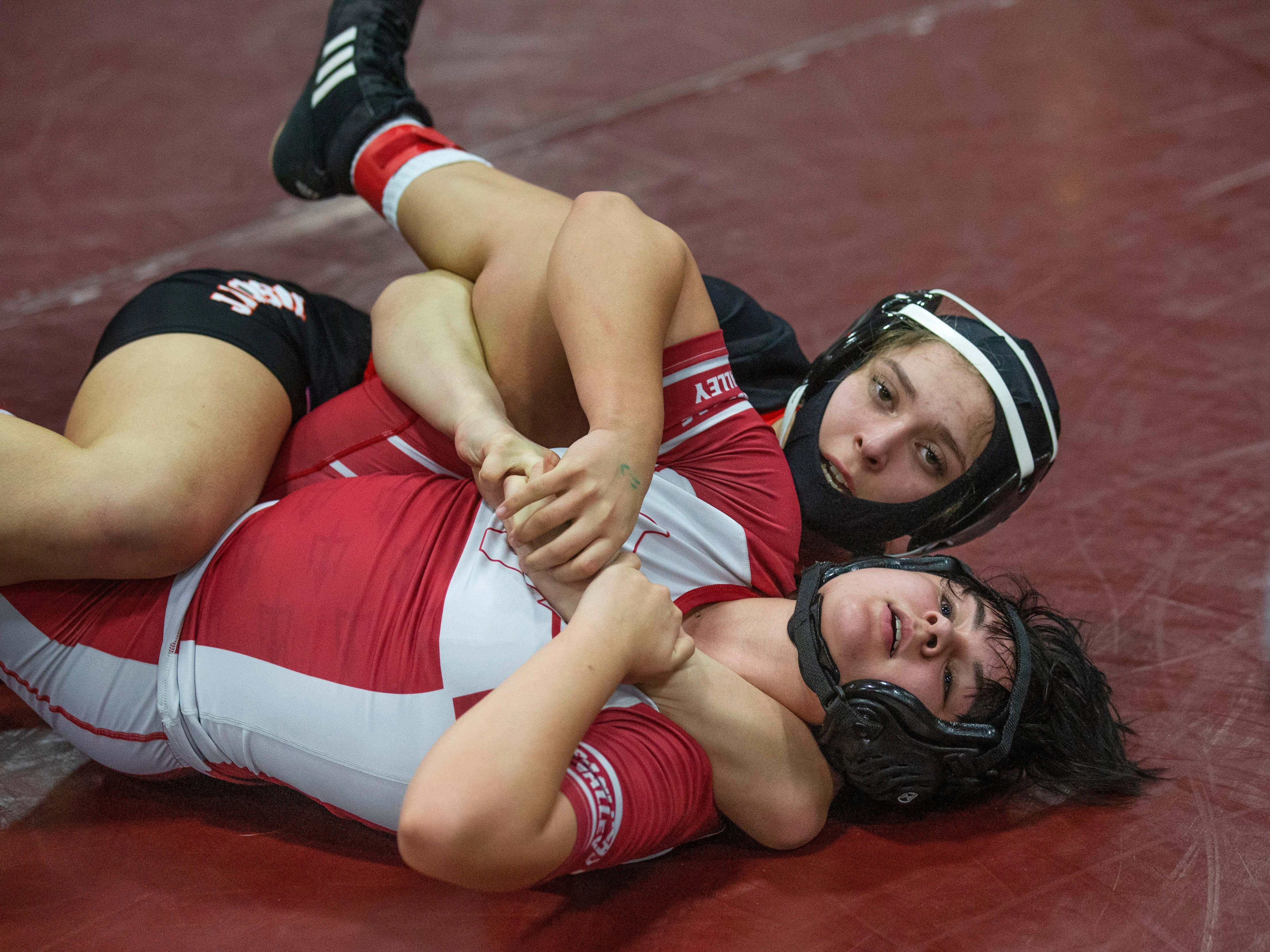 Kayla Gregory works for a pin against Rancocus  Valley's Madison Trotman in their 127 lbs. bout. NJSIAA Girls Region Wrestling at Red Bank Regional High School in Red Bank NJ on February 17, 2019.