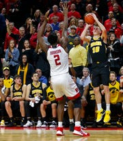 Feb 16, 2019; Piscataway, NJ, USA; Iowa Hawkeyes guard Joe Wieskamp (10) makes the game winning basket against Rutgers Scarlet Knights center Shaquille Doorson (2) during the second half at Rutgers Athletic Center (RAC). Mandatory Credit: Noah K. Murray-USA TODAY Sports