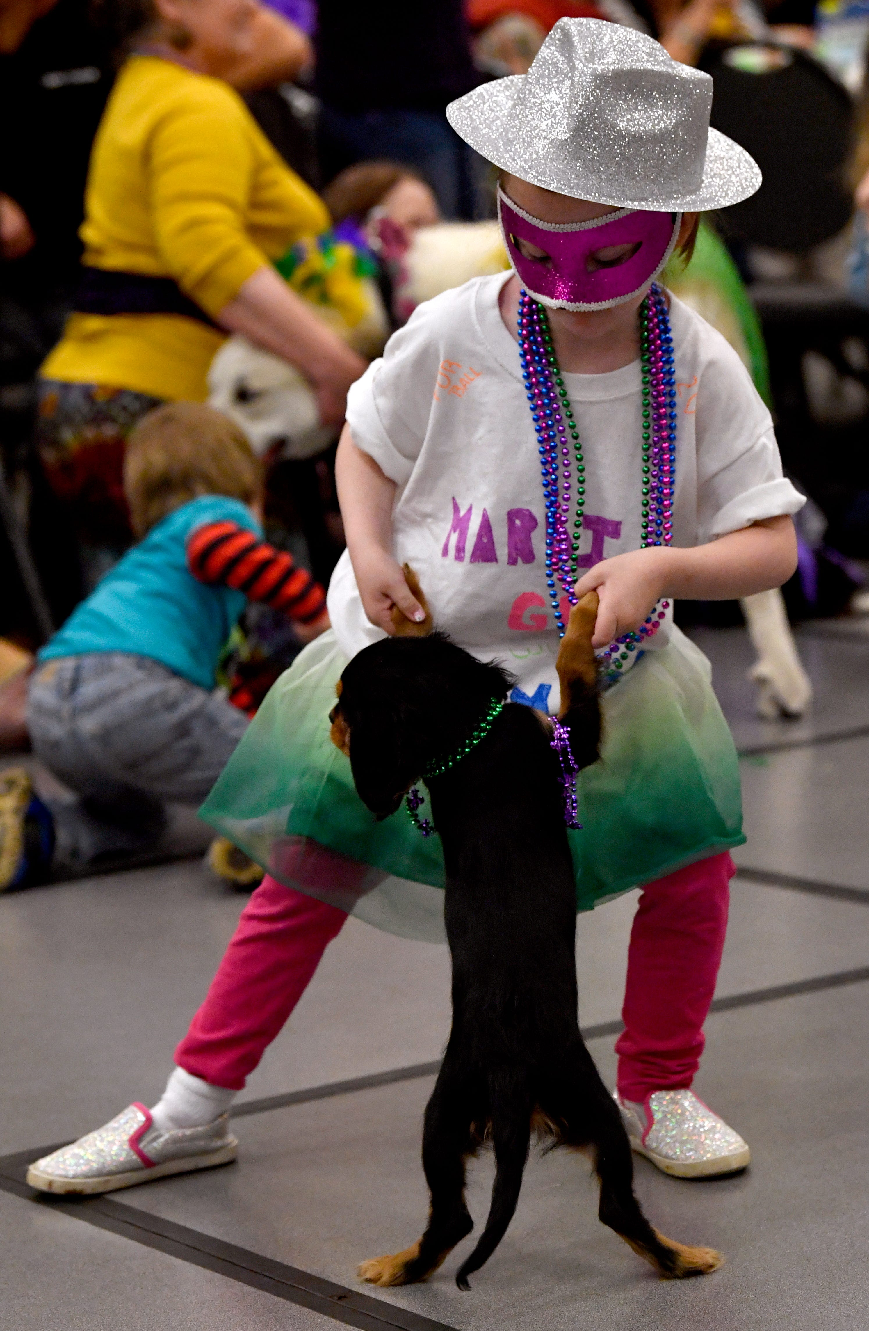 Kynzie Colmery, 6, dances with her Cavalier King Charles Spaniel, Reesie, during the kid's dance contest at the Fur Ball. Reesie and Kynzie took the third-place trophy.