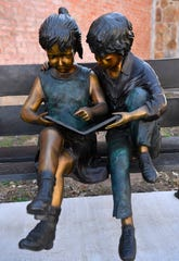 A statue in the park beside the library celebrates the mission of the institution. Wishing to model their park after Abilene's Storybook Garden, donors from around the state and beyond paid for the artwork.