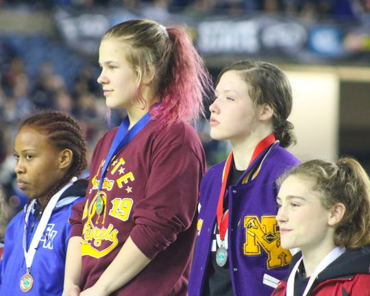 North Kitsap's Holly Beaudoin displays her second-place medal at Mat Classic XXXI.