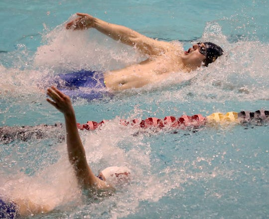 Bainbridge's William Waite (top) competes in the 200-yard IM during Saturday's state meet.