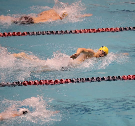 Bainbridge's Jude Wenker (center lane) takes the lead in the 200-yard freestyle during Saturday's Class 3A state swim meet. The Spartans won the team title for the third consecutive year.