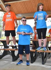 Former FLORIDA TODAY Executive Editor Bob Gabordi, center, has been recovering from a stroke last year. He attended the the first Mayor's Fitness Challenge walk of 2019 at West Melbourne Community Park.