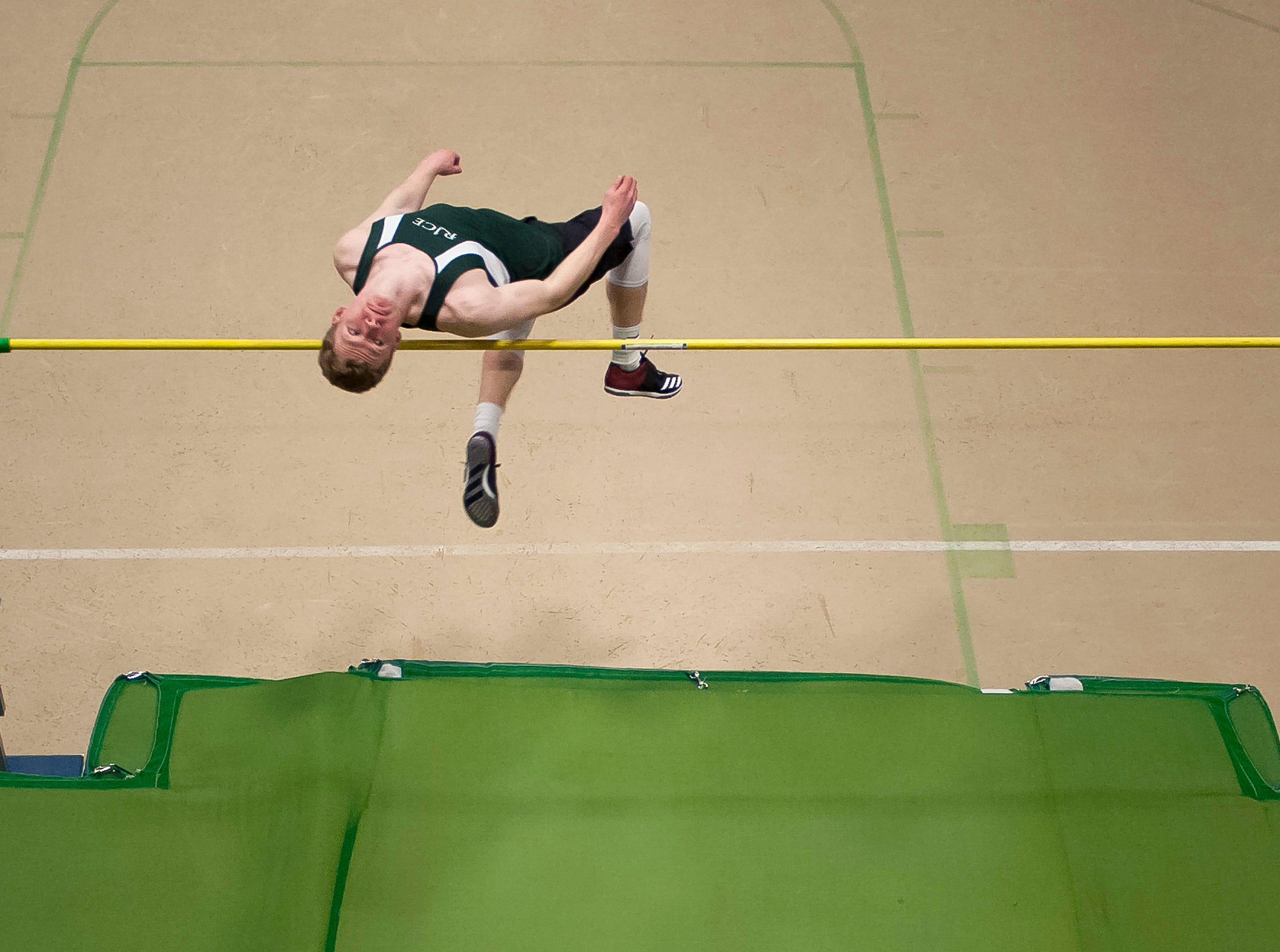 Rice's Davis Lavoie attempts to clear the bar at 6 feet during high jump at the high school indoor track state championships at the University of Vermont on Saturday.