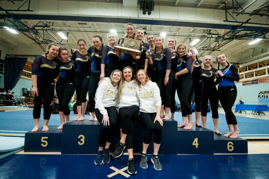 Essex posses for a photo with the championship trophy during the 2019 high school gymnastics championship at Essex High School on Saturday afternoon February 16, 2019 in Essex, Vermont.