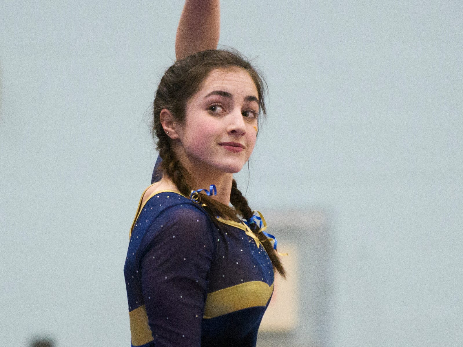 Essex's Livia Ball compete in the bar during the 2019 high school gymnastics championship at Essex High School on Saturday afternoon February 16, 2019 in Essex, Vermont.