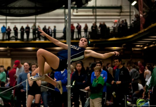 Essex's Hannah Neddo clears the bar in the high jump at the high school indoor track state championships at the University of Vermont on Saturday.