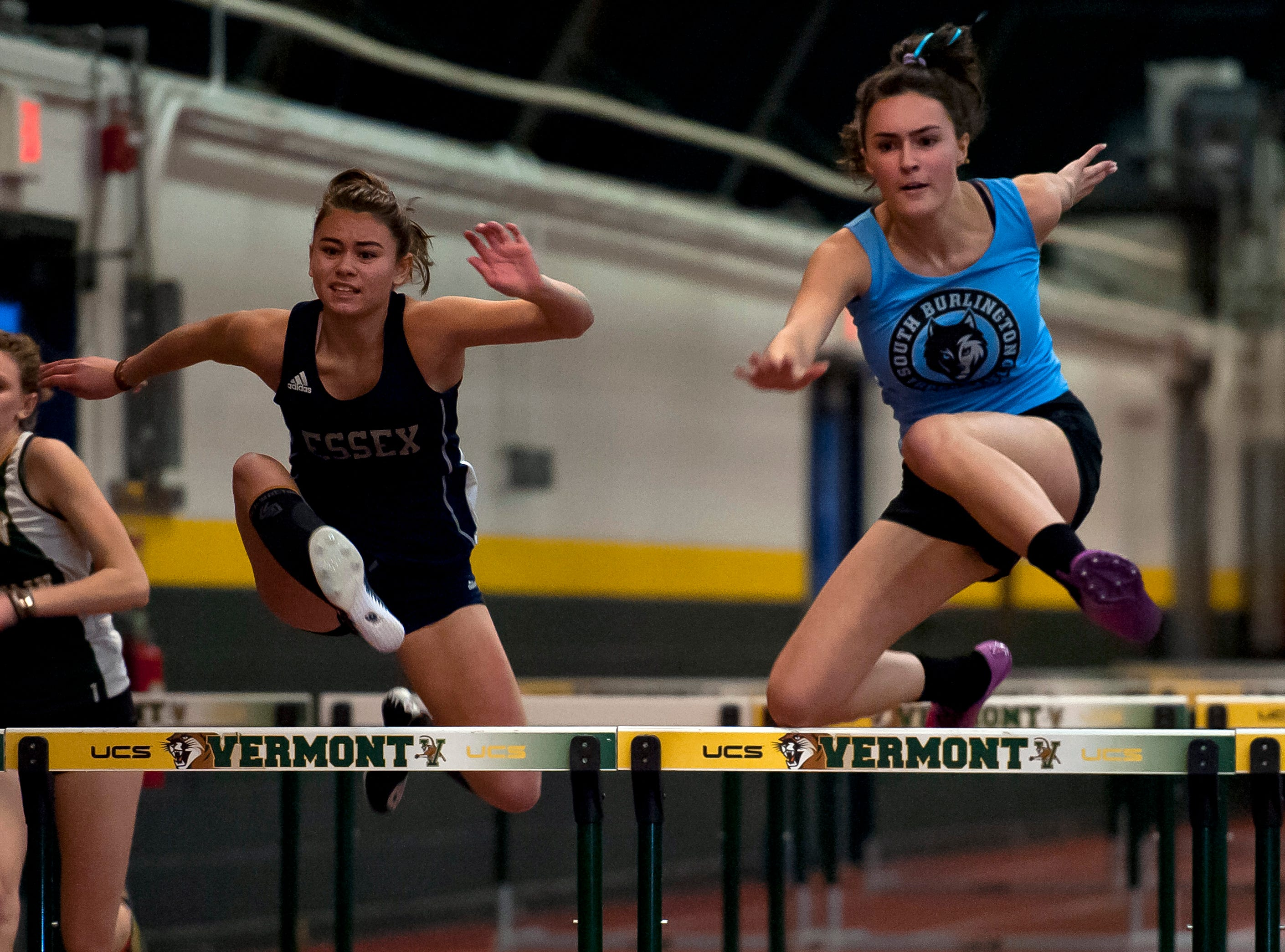 South Burlington's Teresa O'Leary, right, and Essex's Annika Simard approach the final hurdle in the girls 55 hurdles at the high school indoor track state championships at the University of Vermont on Saturday.