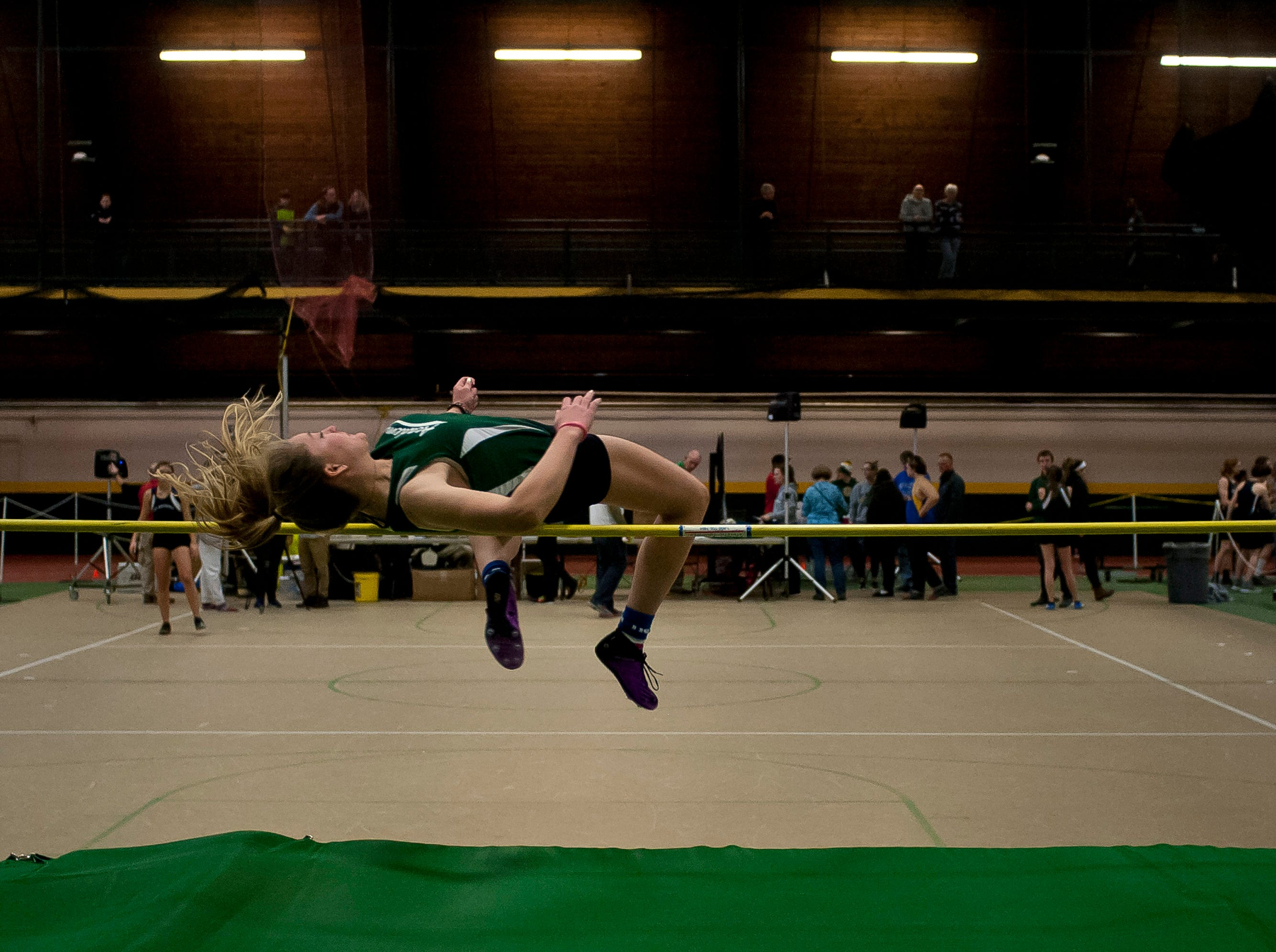 St. Johnsbury's Lilly Leach attempts the high jump at the high school indoor track state championships at the University of Vermont on Saturday.