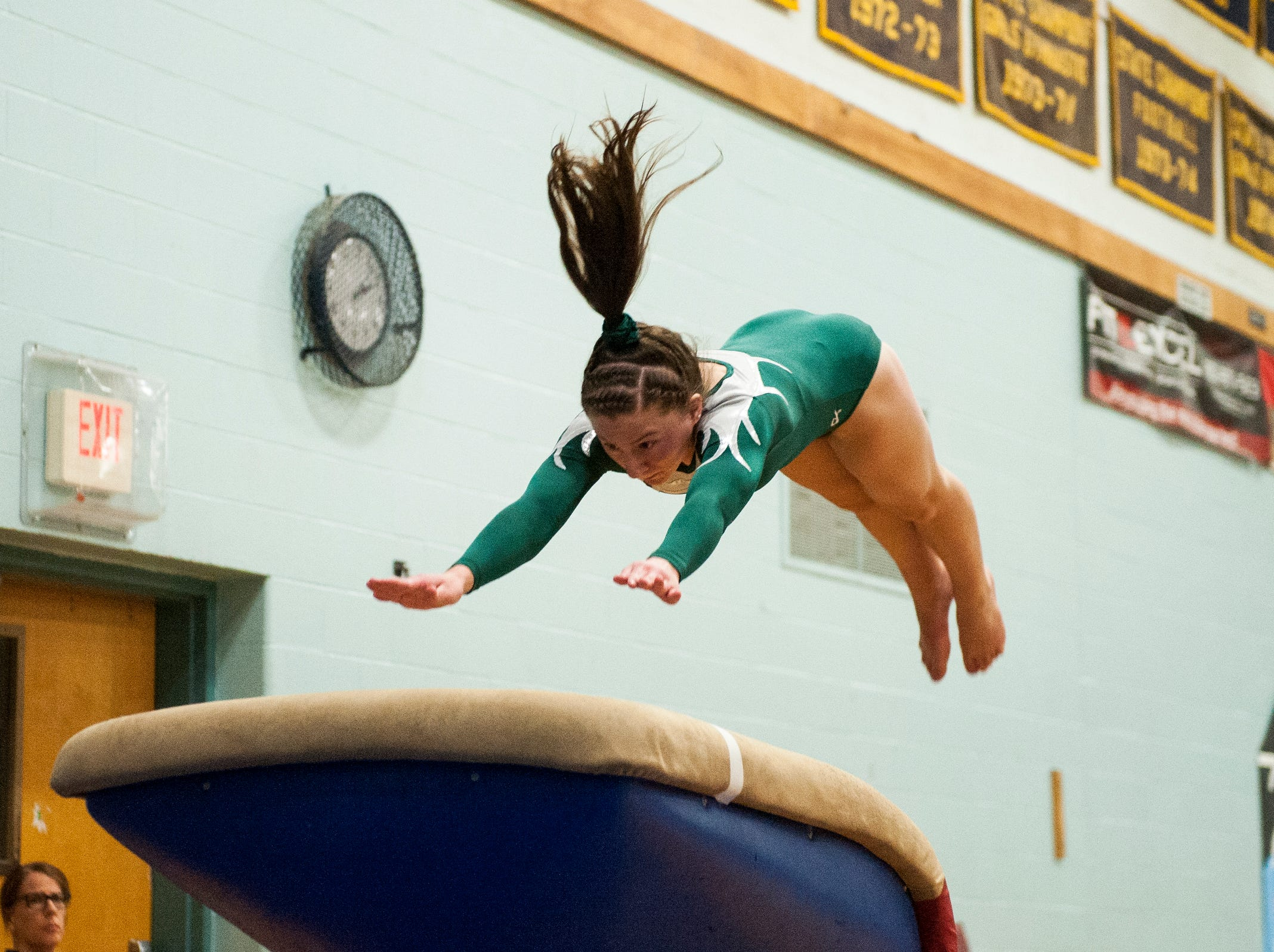 St. Johnsbury's Anna Cushing competes in the vault during the 2019 high school gymnastics championship at Essex High School on Saturday afternoon February 16, 2019 in Essex, Vermont.