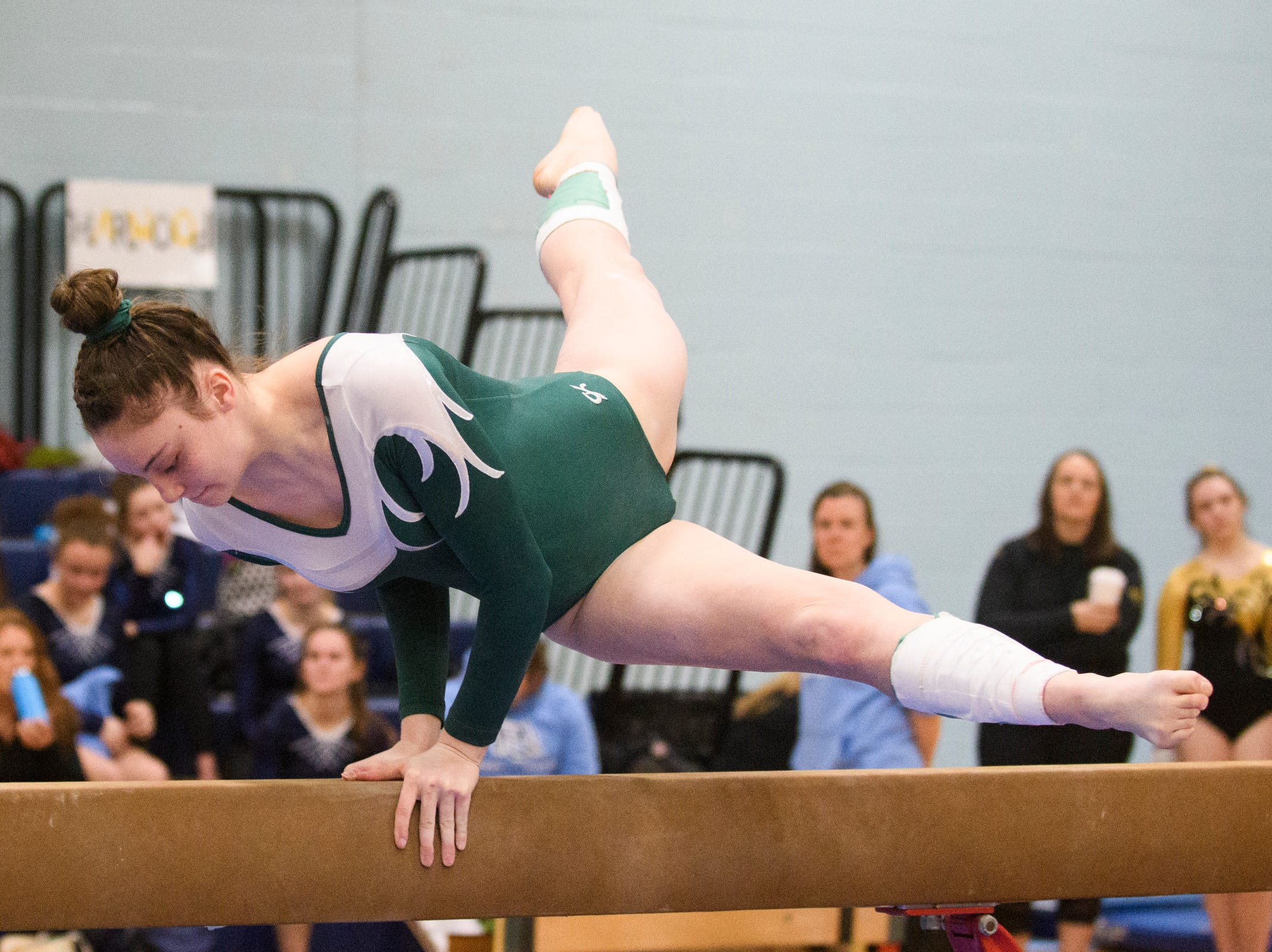 St. Johnsbury's Lizzy Jones competes in the bar during the 2019 high school gymnastics championship at Essex High School on Saturday afternoon February 16, 2019 in Essex, Vermont.