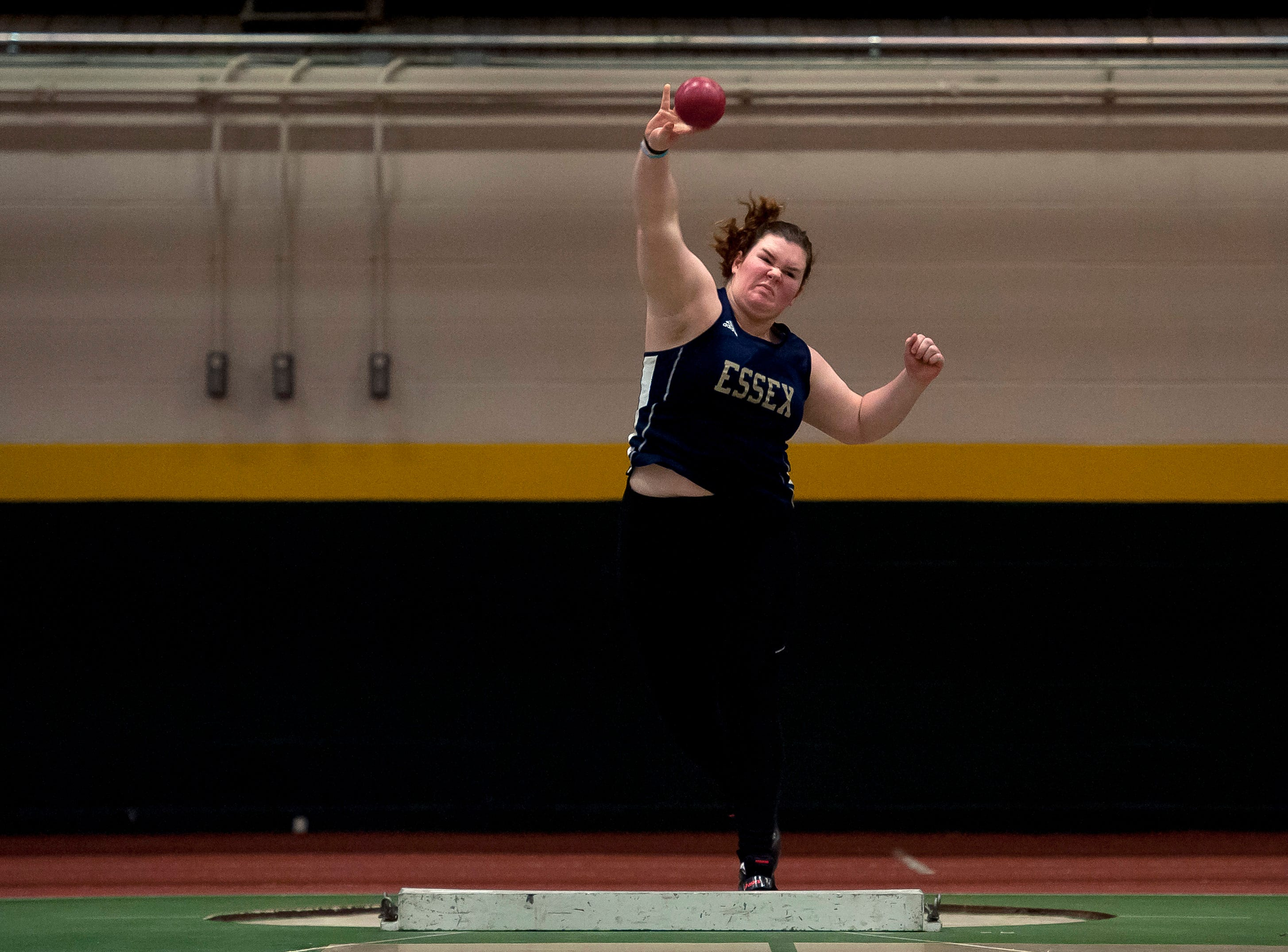 Essex's Maria Campo lets fly with the shot put at the high school indoor track state championships at the University of Vermont on Saturday.