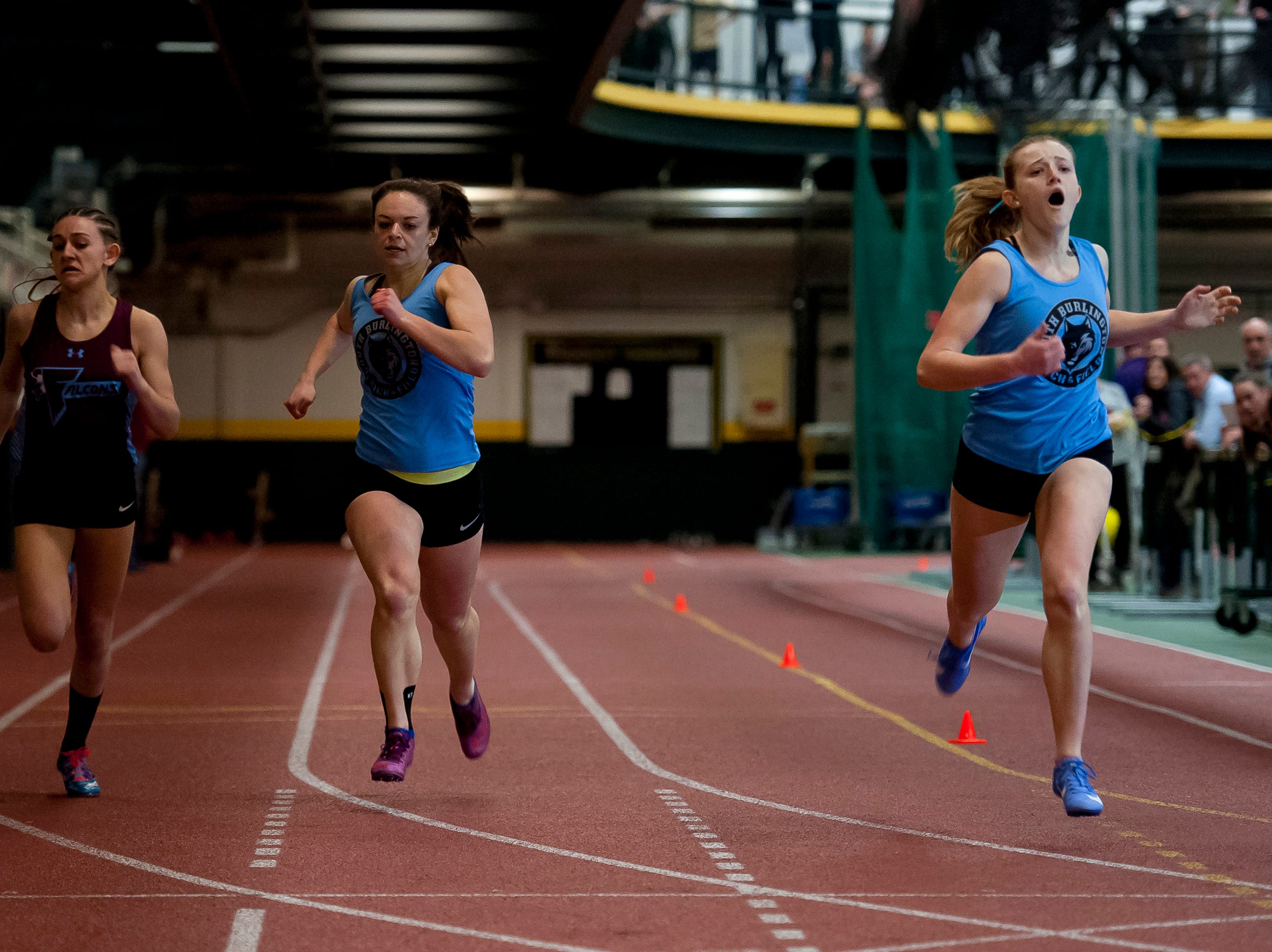 South Burlington's Odessa O'Brien, right, and Cora Kakalec near the finish line alongside North Country's Alexis Lefaivre in the girls 300 meter dash at the high school indoor track state championships at the University of Vermont on Saturday.