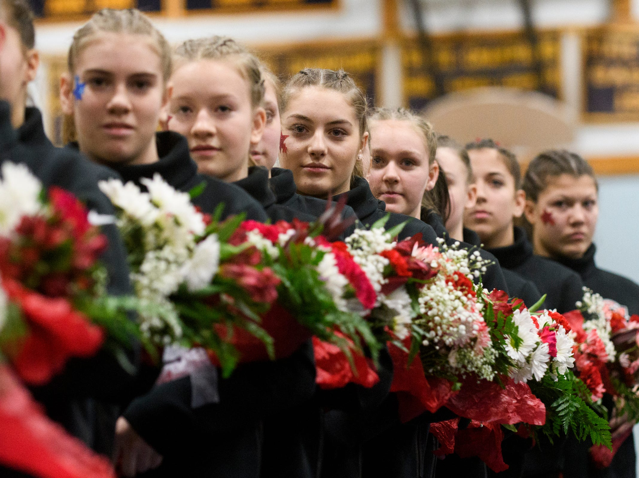 The CVU team during introductions in the 2019 high school gymnastics championship at Essex High School on Saturday afternoon February 16, 2019 in Essex, Vermont.