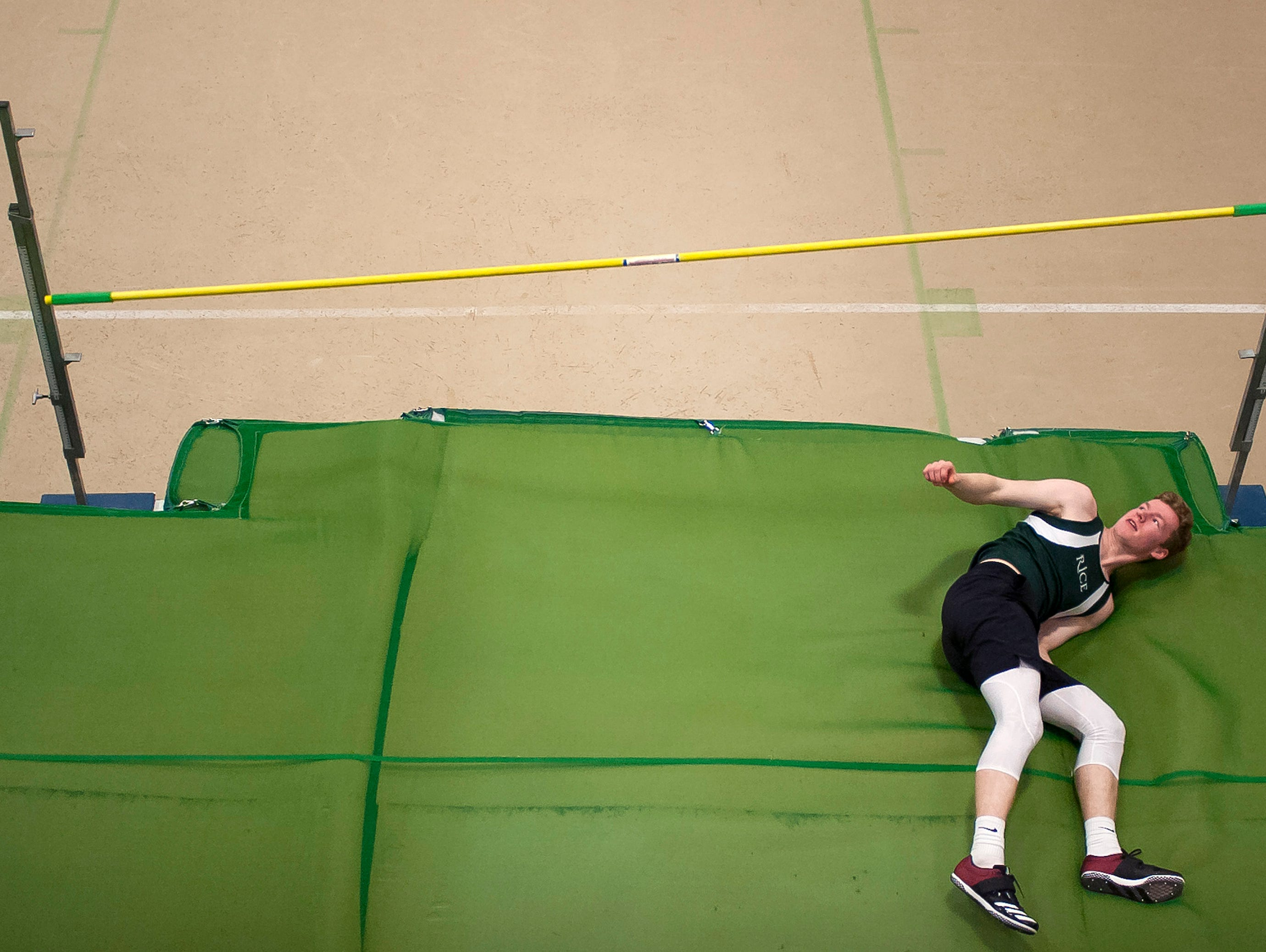 Rice's Davis Lavoie looks back as the bar tumbles in the high jump at the high school indoor track state championships at the University of Vermont on Saturday.