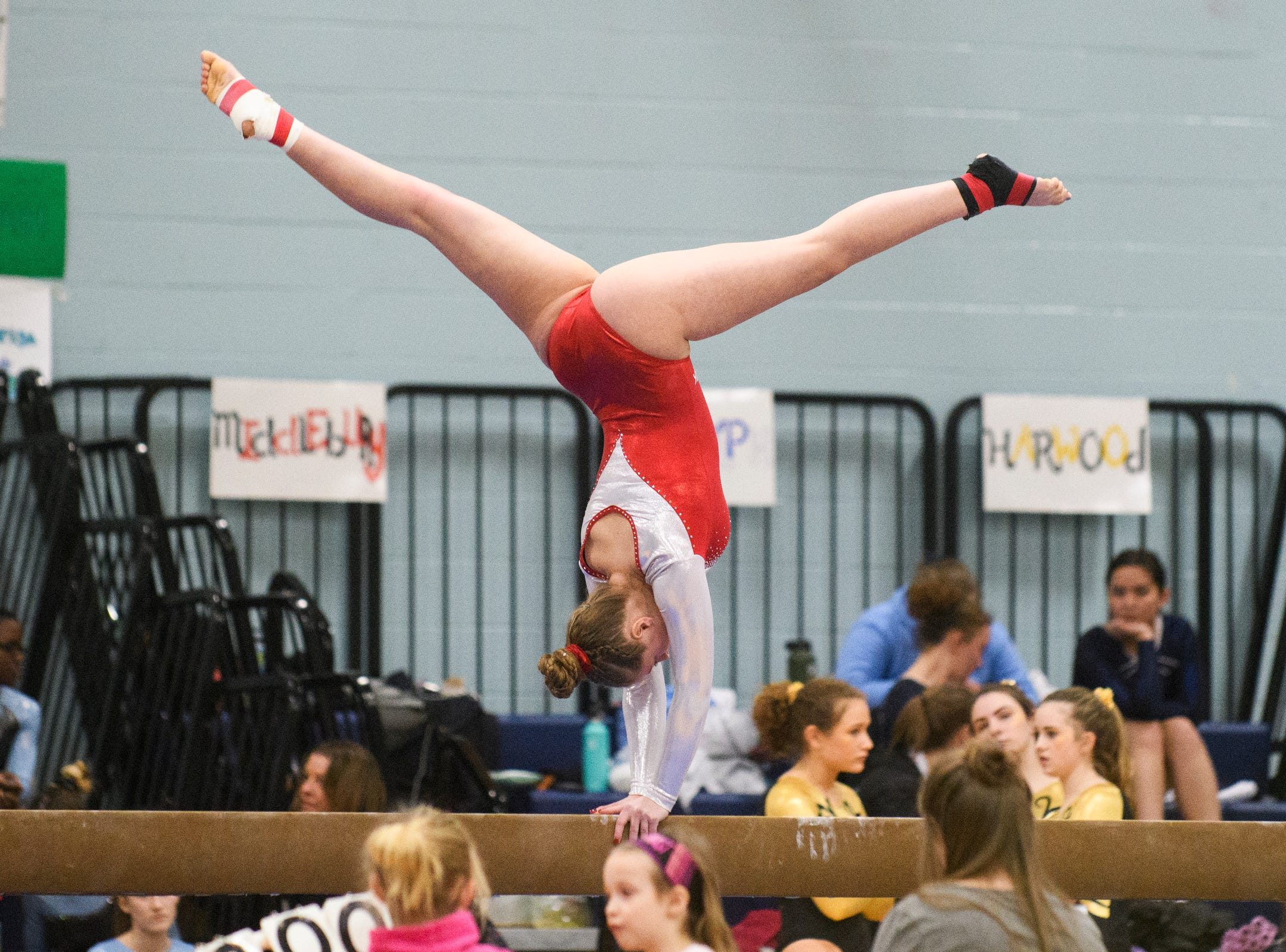 CVU's Alex St. Hilaire competes in the bar during the 2019 high school gymnastics championship at Essex High School on Saturday afternoon February 16, 2019 in Essex, Vermont.