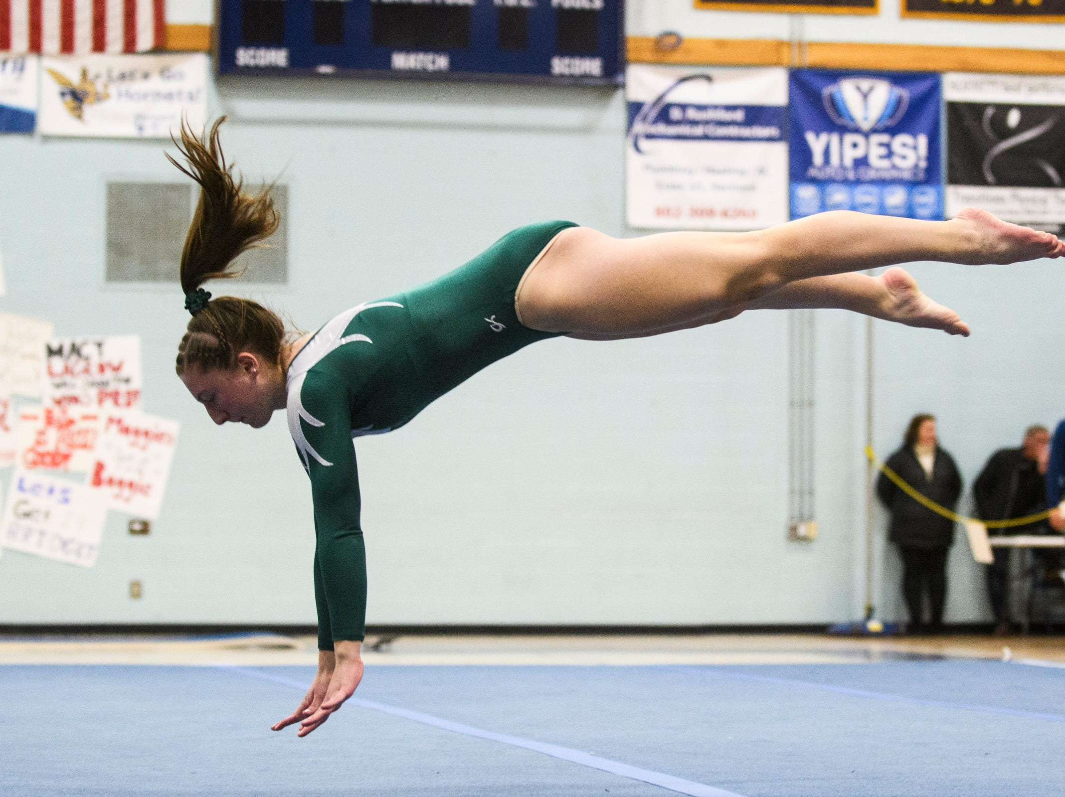 St. Johnsbury's Anna Cushing comets in the floor routine during the 2019 high school gymnastics championship at Essex High School on Saturday afternoon February 16, 2019 in Essex, Vermont.
