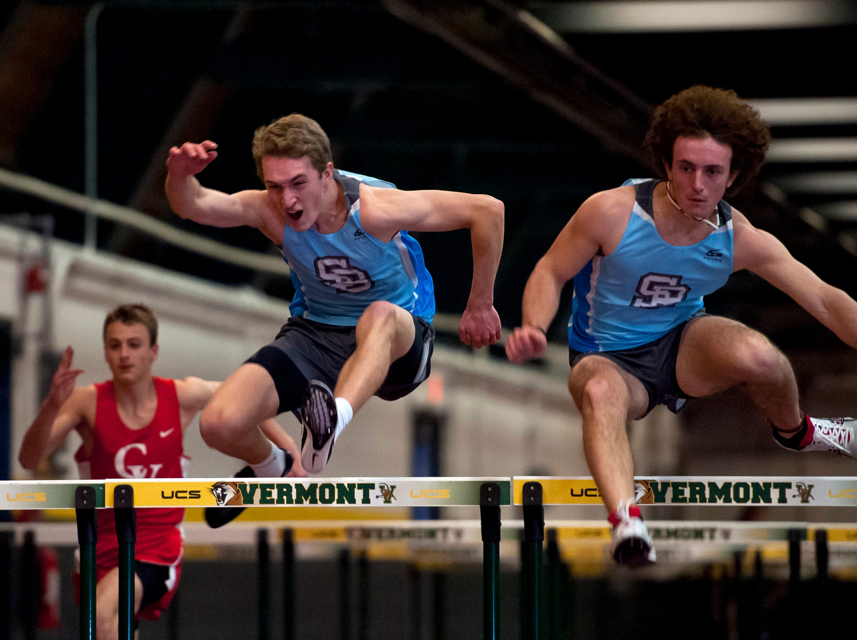 South Burlington's Justo Velez, right, and Quinn Pidgeon clear the final obstacle in the boys 55 hurdles at the high school indoor track state championships at the University of Vermont on Saturday.