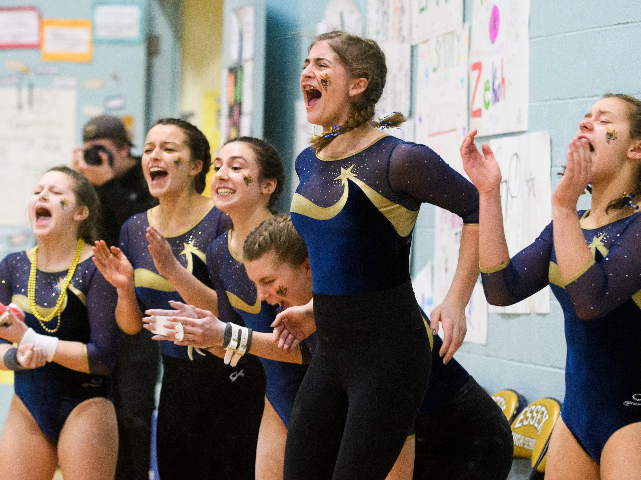 Essex cheers on their teammate during the 2019 high school gymnastics championship at Essex High School on Saturday afternoon February 16, 2019 in Essex, Vermont.