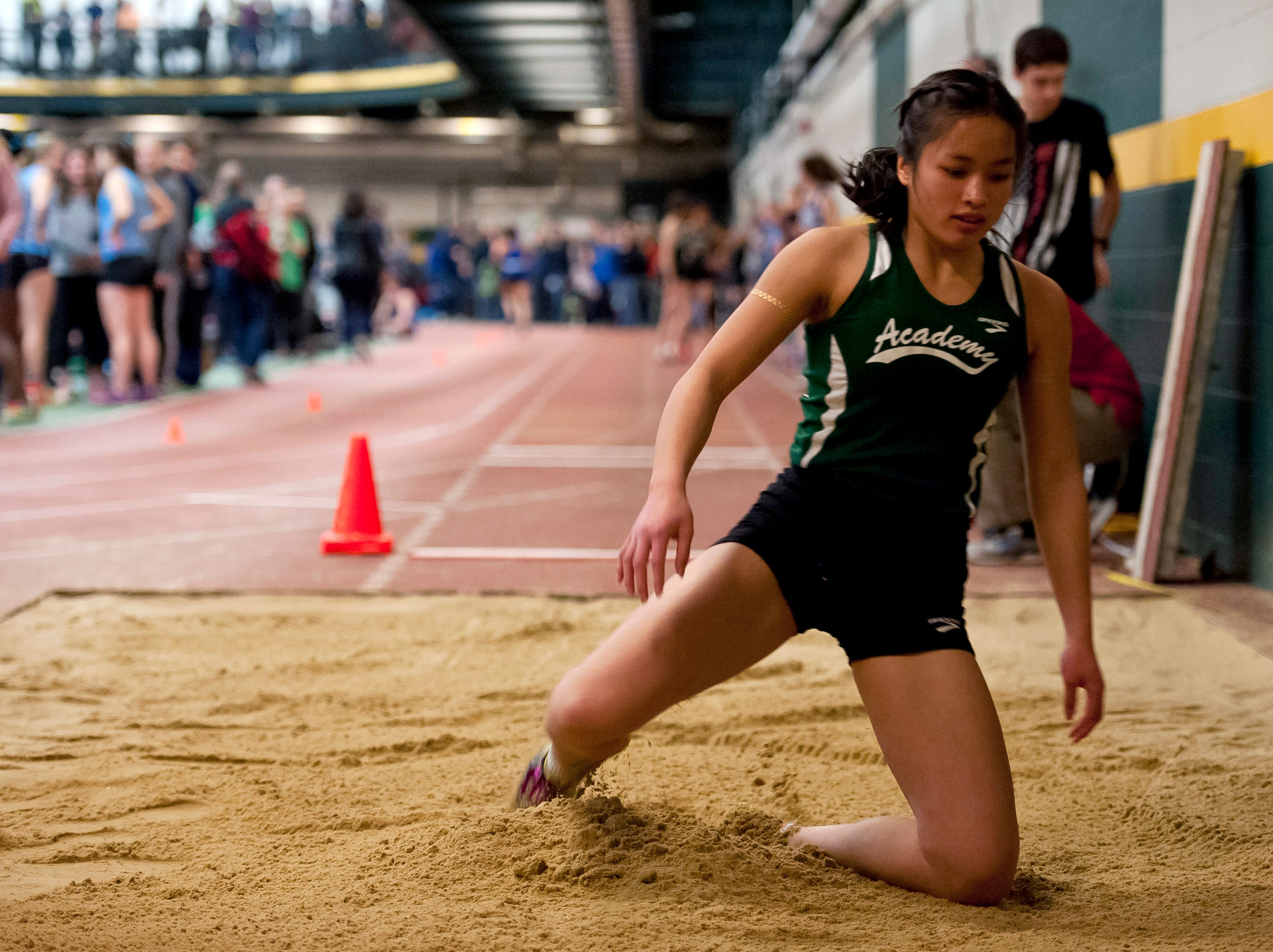 St. Johnsbury's Jen Rotti lands an attempt in the long jump at the high school indoor track state championships at the University of Vermont on Saturday.