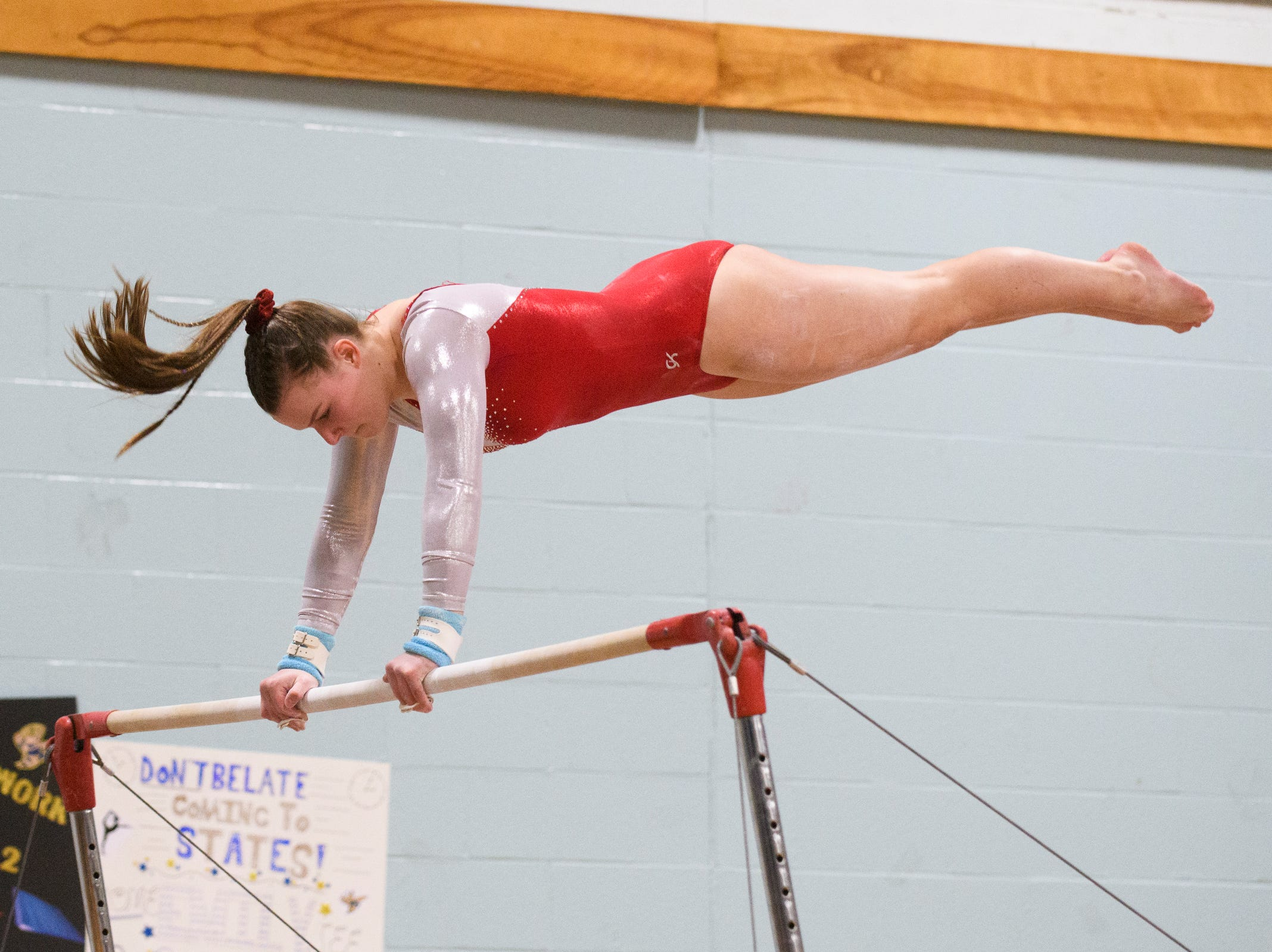 CVU's Delany Miller-Bottoms competes in the bars during the 2019 high school gymnastics championship at Essex High School on Saturday afternoon February 16, 2019 in Essex, Vermont.