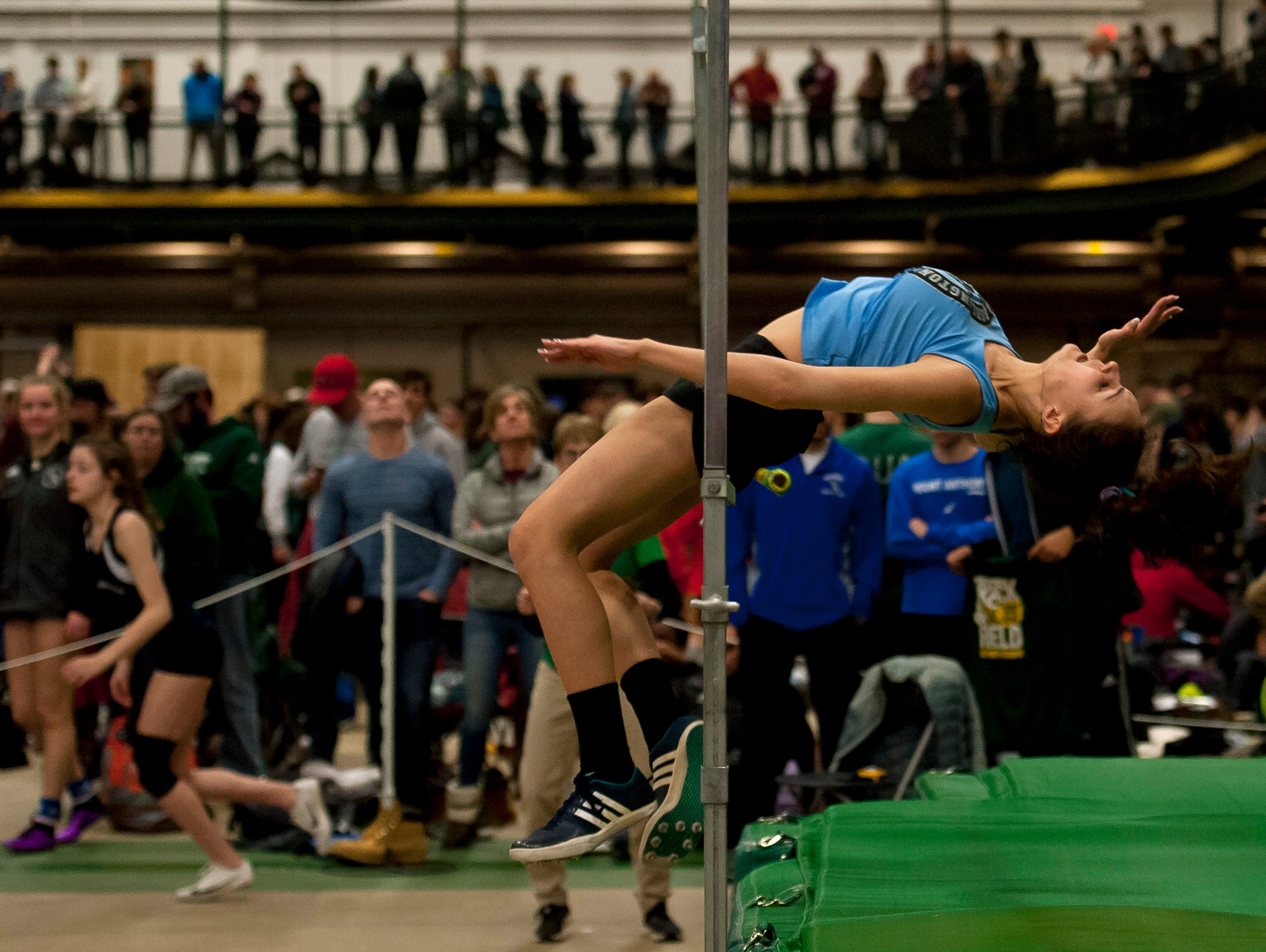 South Burlington's Teresa O'Leary tries to clear the bar in the girls high jump at the high school indoor track state championships at the University of Vermont on Saturday.