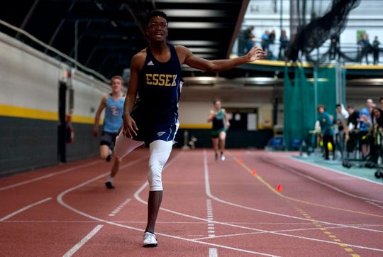 Essex's Jamaal Hankey crosses the finish line with the winning time in the boys 300 meters at the high school indoor track state championships at the University of Vermont on Saturday.